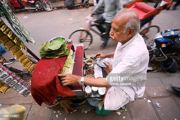 CONTENT] Street vendor selling Betel quids in Delhi India Pieces of Areca nut are wrapped with Betel leaf and a few other ingredients and the bitter...
