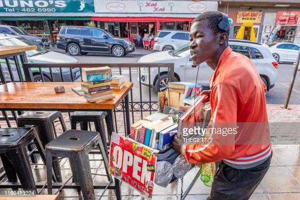 street vendor selling books from his trolley in melville - gauteng province stock pictures, royalty-free photos & images