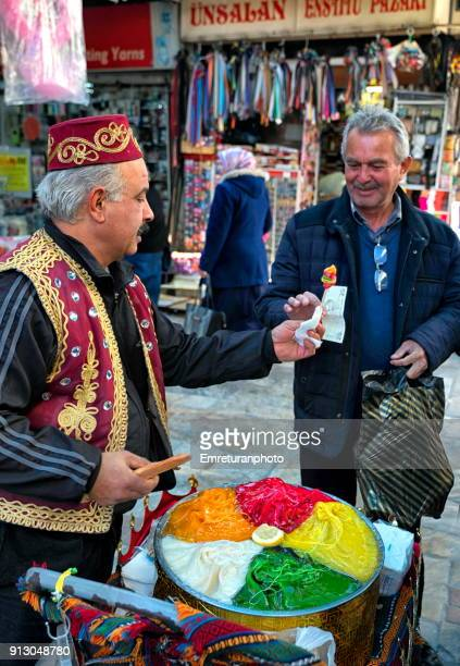 street vendor selling colored candy paste at kemeralti,izmir. - emreturanphoto stock pictures, royalty-free photos & images