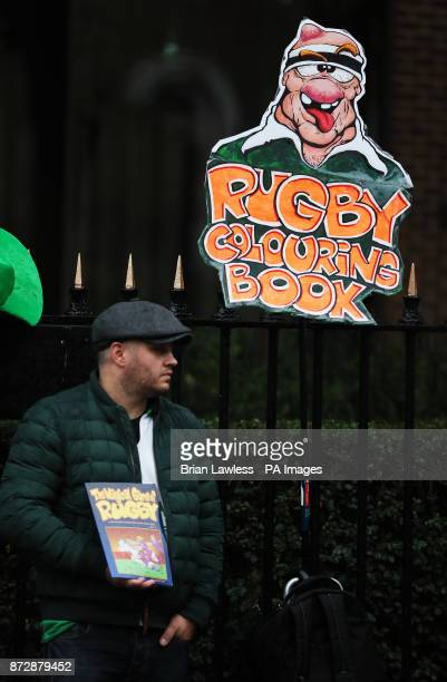 A street vendor selling colouring books ahead of the Autumn International at the Aviva Stadium Dublin