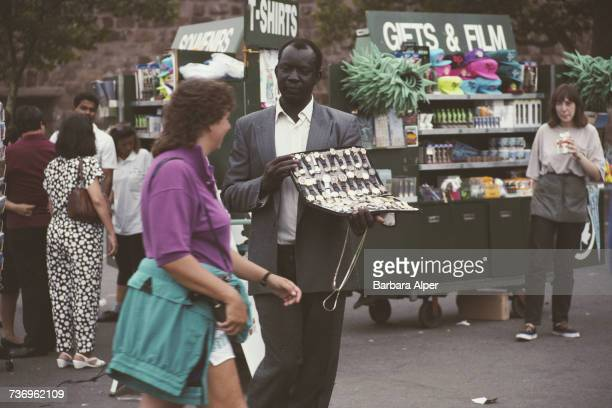 A street vendor selling counterfeit watches in Battery Park Manhattan New York City July 1991