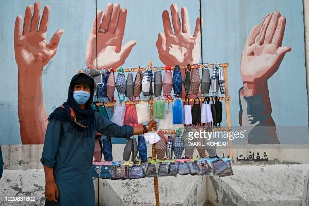 Street vendor selling facemasks wait for customers in Kabul June 18, 2020. - Early optimism that South Asia might have dodged the worst ravages of...
