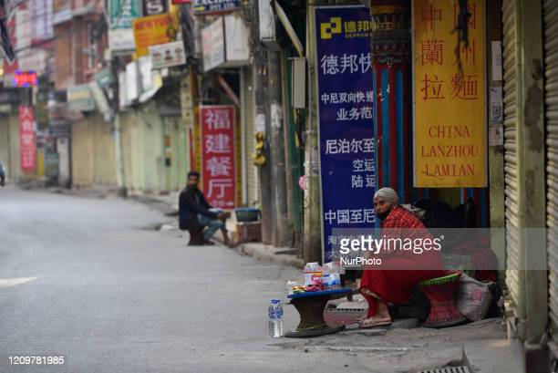 Street vendor selling food in empty narrow alleys of Thamel tourist industry area during the complete nationwide lockdown as concerns about the...