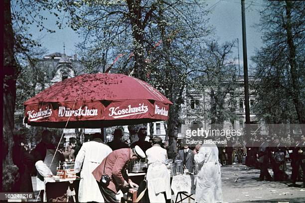 A street vendor selling Koschwitz sausages in downtown Berlin 1st May 1937 At the Lustgarten Adolf Hitler chancellor of Germany delivered a speech in...