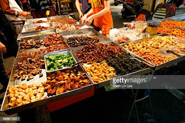 CONTENT] Street vendor selling lu wei at Kaohsiung's Liuhe Night Market Taiwan Lu Wei refers to a wide varities of braised meat tofu and other...