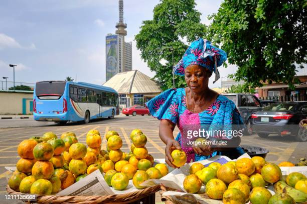 Street vendor selling oranges on the streets of downtown Lagos.