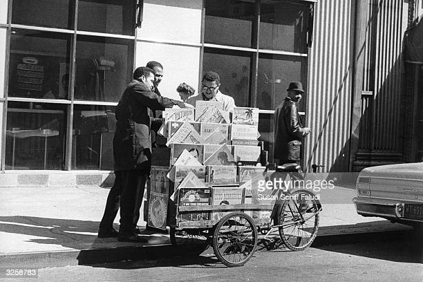 Street vendor selling popular Mexican and Puerto Rican records on the streets of Spanish Harlem, New York.