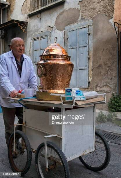 """street vendor selling """"salep"""" at kemeralti,izmir. - emreturanphoto stock pictures, royalty-free photos & images"""