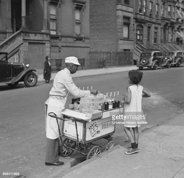 Street Vendor Selling Shaved Ice to Young Girl New York City New York USA Jack Allison Office of War Information July 1938