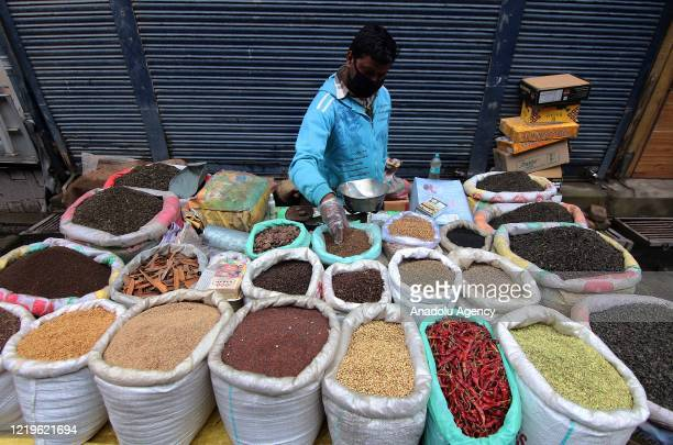 A street vendor selling spices in Srinagar Kashmir on June 13 2020 Markets in Srinagar reopen for the first time on rotational basis since the...