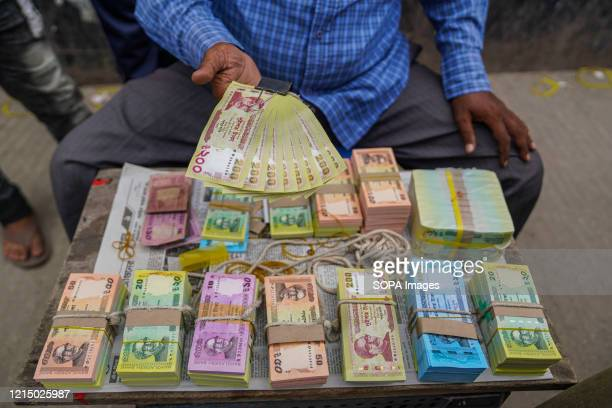 Street vendor selling the highly demanded fresh bank notes ahead of the Eid festival. Fresh notes are offered for salami during the Eid festivals....