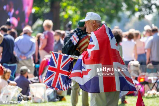 Street vendor selling Union Jack Flags to the crowds of people gathering in Windsor Great Park to celebrate the marriage of Meghan Markle and Prince Harry