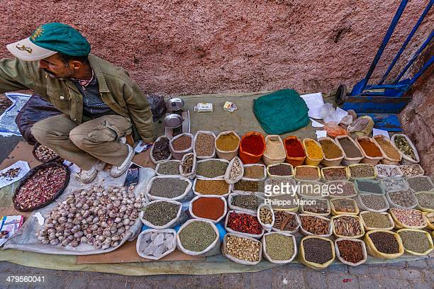 CONTENT] Street vendor selling various colorful spices in the narrow streets of the souk in Marrakesh Morocco