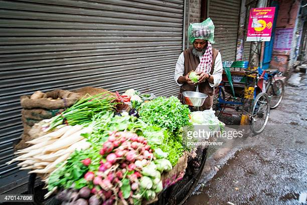 Street Vendor Selling Vegetables in Old Delhi, India