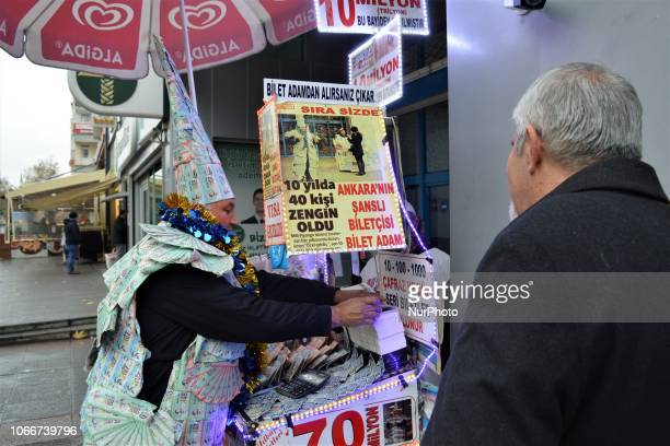 A street vendor sells a New Year's lottery ticket to a customer in the Kizilay district of Ankara Turkey on November 30 2018 This year's lottery...