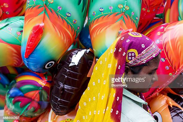 A street vendor sells balloons in Nashik Maharashtra India on Saturday Sept 12 2015 Millions of pilgrims in a landscape awash in saffron make their...