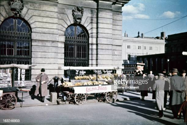 A street vendor sells bananas and other fruit next to the Zeughaus at the corner of Hinter dem Gießhaus and Unter den Linden 1st May 1937 The cart on...