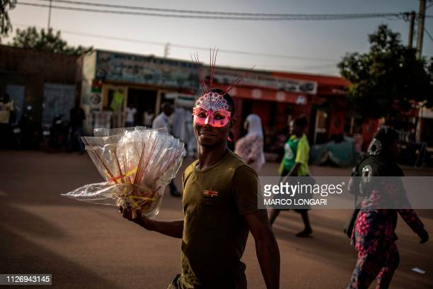 Street vendor sells carnival masks outside the venue of the opening ceremony of the FESPACO The Panafrican Film and Television Festival of...