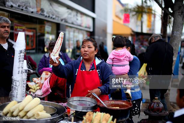 A street vendor sells corn on the cob to customers along Calle Avenida Revolucion inTijuana Mexico on Monday January 30 2012 The US State Department...