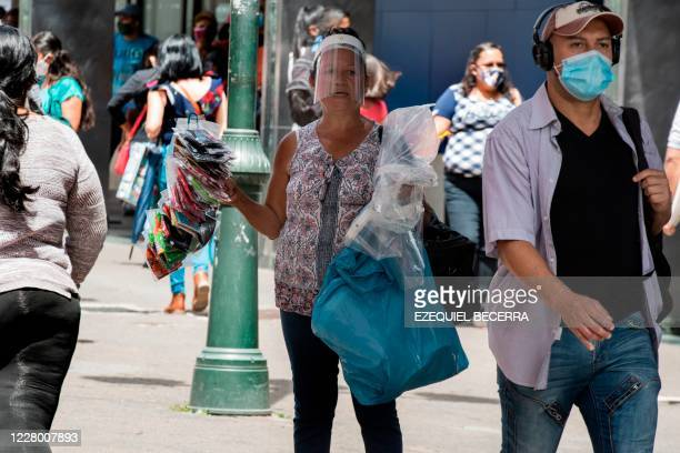 Street vendor sells face masks in San Jose, Costa Rica on July 20, 2020 amid the coronavirus COVID-19 pandemic. - Most people working informally in...