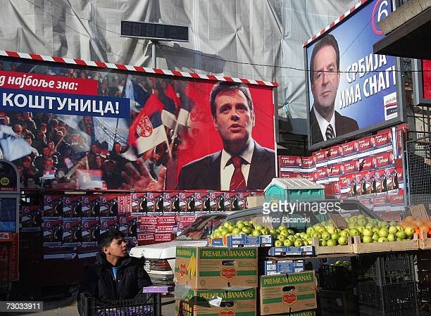 A street vendor sells fruit in front of election posters for Vojislav Kostunica the Serbian Prime Minister and leader of the Democratic Party of...
