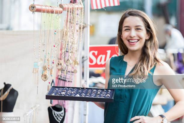 Street vendor sells jewelry in a large city
