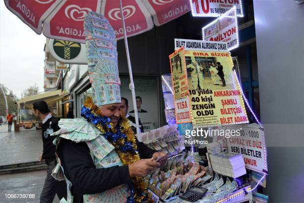 A street vendor sells New Year's lottery tickets in the Kizilay district of Ankara Turkey on November 30 2018 This year's lottery raffle in Turkey...