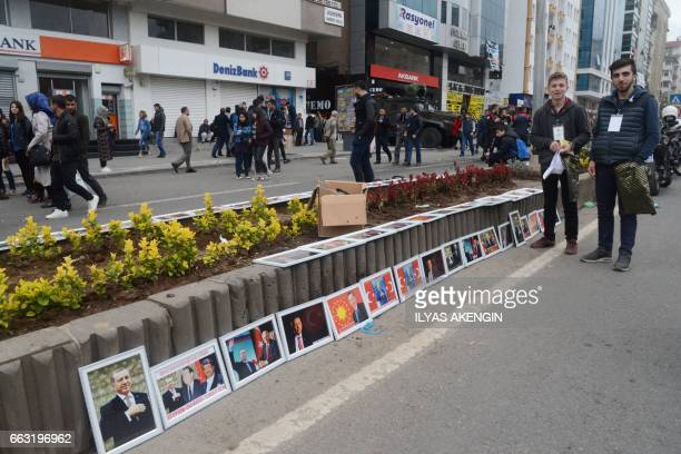 A street vendor sells pcitures of Turkish President Recep Tayyip Erdogan during a rally for the 'YES' in Diyarbakir on April 1 two weeks ahead of a...