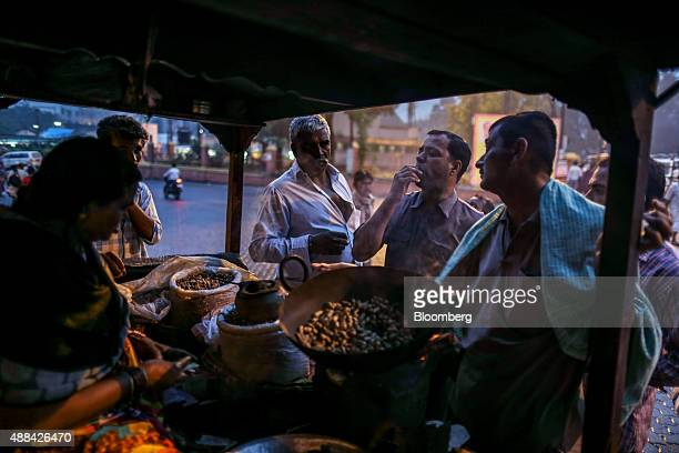 A street vendor sells peanuts in Nashik Maharashtra India on Saturday Sept 12 2015 Millions of pilgrims in a landscape awash in saffron make their...