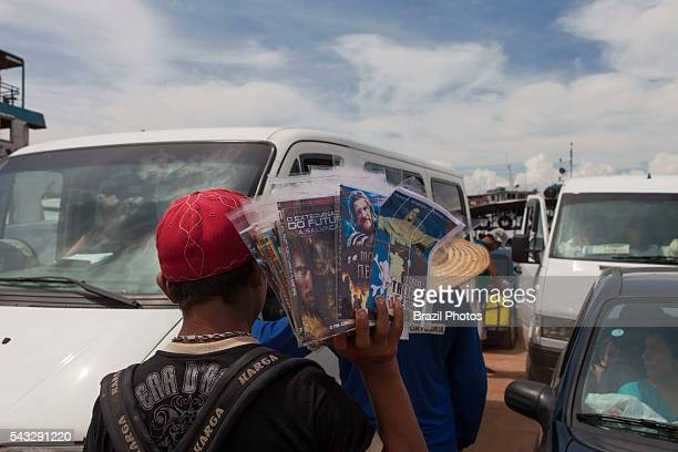 Street vendor sells pirate movie DVDs in ferryboat at Manaus city Brazil