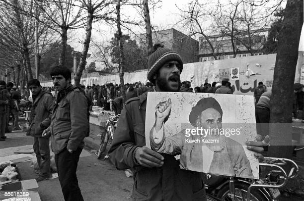 A street vendor sells posters of Ayatollah Khomeini on Revolution Street in Tehran 10th December 1979 Around Tehran University where Friday Prayers...
