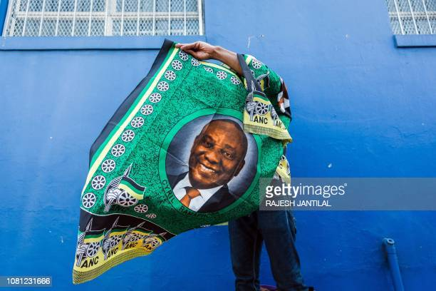 TOPSHOT A street vendor sells regalia depicting South African President Cyril Ramaphosa outside the venue for the African National Congress 107th...