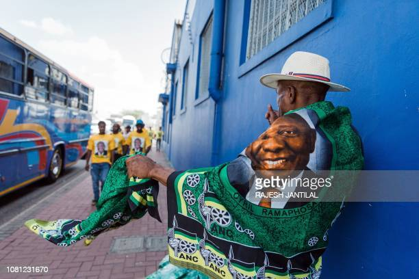 A street vendor sells regalia depicting South African President Cyril Ramaphosa outside the venue for the African National Congress 107th anniversary...