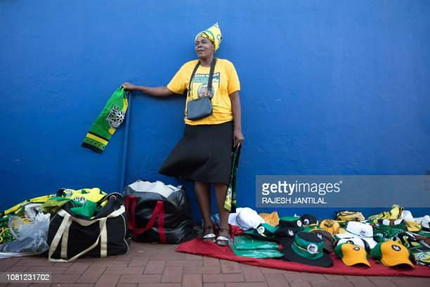 A street vendor sells regalia outside the venue for the African National Congress 107th anniversary celebrations at the Moses Mabhida Stadium in...