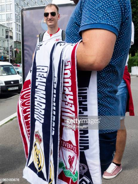 A street vendor sells scarves to football fans of both teams On Saturday May 26 Kiev will host the finals of the largest and most prestigious...