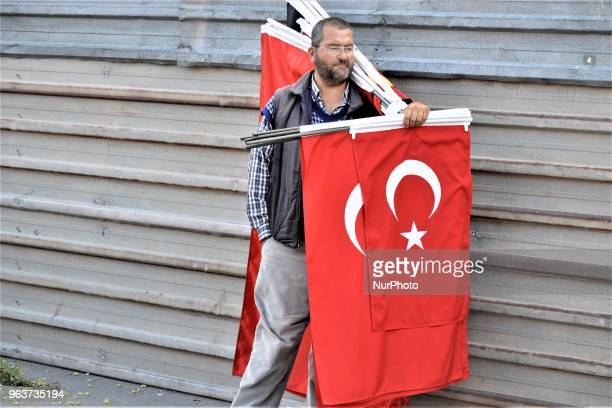 A street vendor sells Turkish flags near a bazaar during the Muslim holy fasting month of Ramadan in the historic Ulus district of Ankara Turkey on...