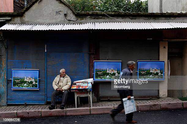 A street vendor sits in the Fener Balat neighborhood of Istanbul Turkey on Monday Oct 18 2010 Turkish developers are flocking to centrallylocated but...