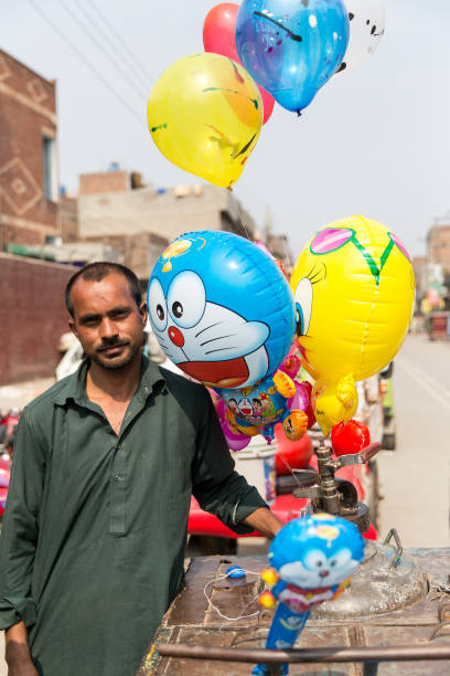 A street vendor who is selling balloons on February 27 2014 in Lahore Pakistan Lahore is the capital city of the Pakistani province of Punjab the...