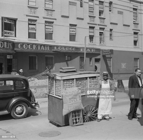 Street Vendor with Peanut Wagon Lenox Avenue and 133rd Street New York City New York USA Jack Allison Office of War Information July 1938