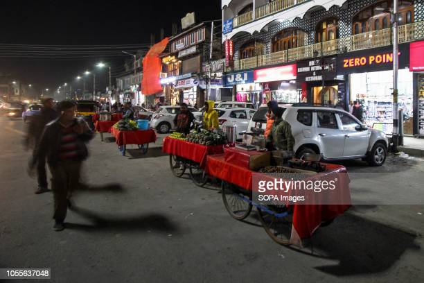 Street vendors are seen waiting for customers at Lal Chowk the main market in central Srinagar the summer capital of Indian administered Kashmir...