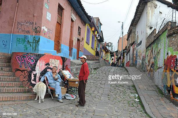 Street vendors at the entrance of an old alley way in Candeleria old part of the city Bogota formerly called Santa Fe de Bogota is the capital city...