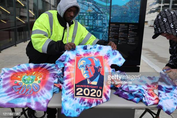 Street vendors attempt to make a few sales after Democratic presidential candidate Sen Bernie Sanders canceled his campaign event due to concerns...