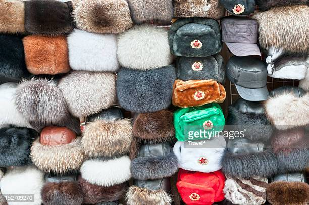 street vendor's display of hats - russian style - fur hat stock photos and pictures