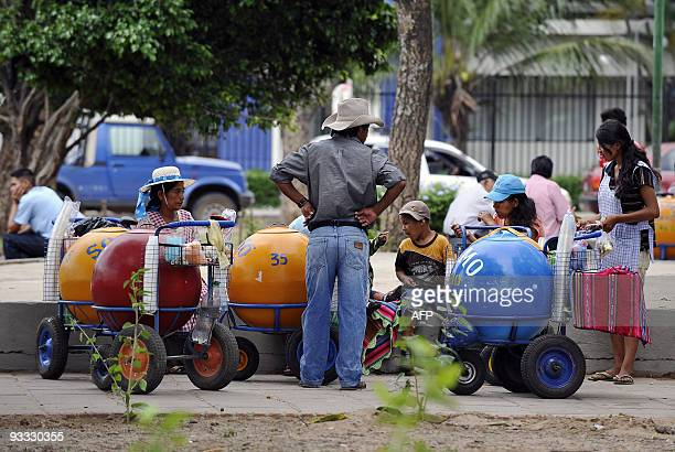 Street vendors offer maize chicha in an outlying neighbourhood in Santa Cruz on November 21 2009 Due to its political and economic weight in the...