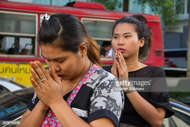 Street vendors pray at a religious ceremony to honor victims of the deadly bombing at the Erawan Shrine in Bangkok, Thailand. At least 21 people were...