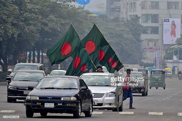 Street vendors sell Bangladeshi national flags near the national parliament building in Dhaka on December 13 ahead of the country's 44th Victory Day...