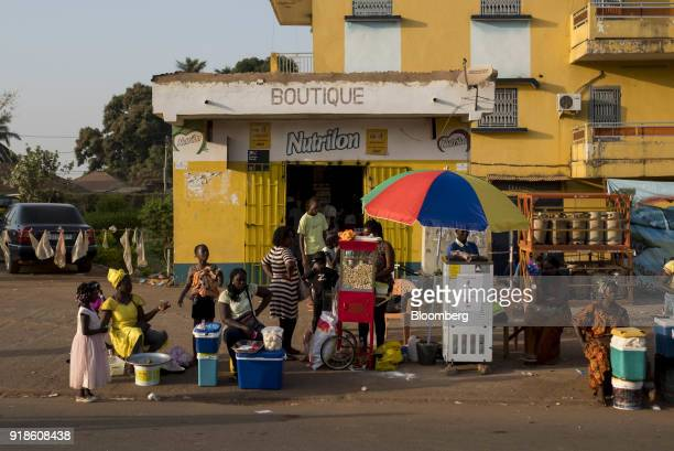 Street vendors sell food and goods on a street in Bissau GuineaBissau on Sunday Feb 11 2018 The International Monetary Fund said an increase in...