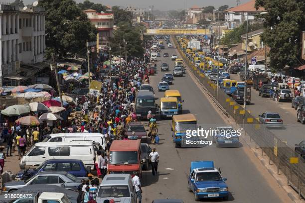 Street vendors sell food and goods on the roadside at Bandim market in Bissau GuineaBissau on Monday Feb 12 2018 The International Monetary Fund said...