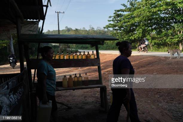 Street vendors sell gasoline in bottles on the side of a road in East Kalimantan, Borneo, Indonesia, on Wednesday, Nov. 27, 2019. For Jakarta, a city...