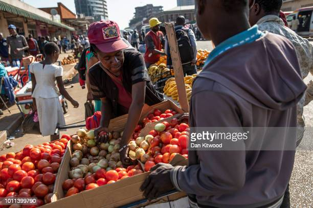 Street vendors sell goods in a market on August 05 2018 in Harare Zimbabwe Zimbabwe Electoral Commission officials have announced the reelection of...